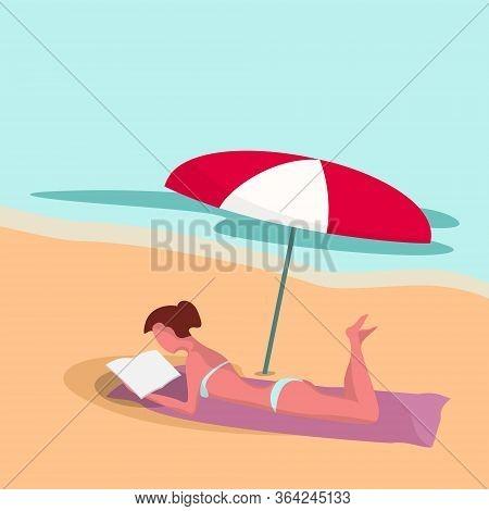 Woman On The Beach Under Umbrella Reads The Book. Summer. Ocean.