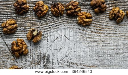Walnut Scattered On The Wooden Vintage Table. Walnuts Is A Healthy Vegetarian Protein Nutritious Foo