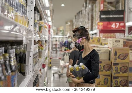 Bangkok, Thailand - May 02: Unnamed Woman Shops In Makro Wholesale Market Wearing Mask And Goggle Du