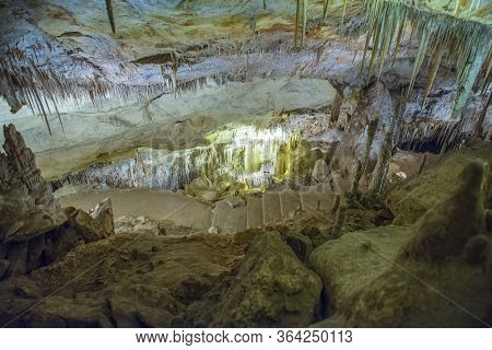 Stalactite Illuminated Caves In Spain On The Island Of Mallorca. Multi-colored Illumination Of Caves