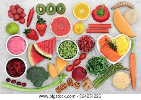 Healthy heart & immune boosting super food with health foods high in fibre, antioxidants, anthocyanins, lycopene, vitamins, omega 3 & protein to support the cardiovascular system. Low GI. Flat lay.
