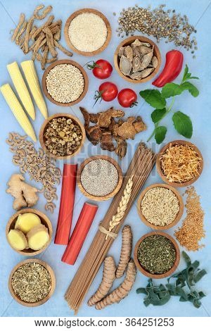 Health food to ease irritable bowel syndrome. Healthy foods to boost immune system high in antioxidants, protein, dietary fiber, vitamins, minerals, omega 3, smart carbs & anthocyanins. Flat lay.