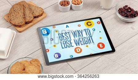 Healthy Tablet Pc compostion with BEST WAY TO LOSE WEIGHT inscription, weight loss concept