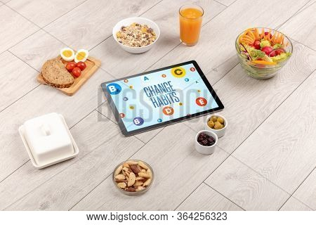 Healthy Tablet Pc compostion with CHANGE HABITS inscription, weight loss concept
