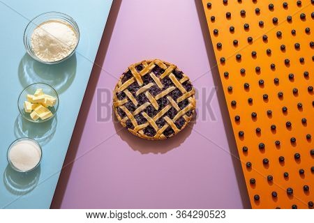 Making Of Blueberry Pie With A Lattice Crust On Tricolor Seamless Background. Flat Lay With Blueberr