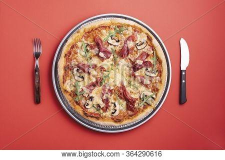Homemade Pizza With Prosciutto Crudo, Arugula, Mozzarella And Champignons. Flat Lay With A Ham Pizza
