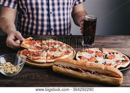 Comfort Food, Addiction, Eating Disorders, Bulimia. Overweight Man Eating Junk Food And Drink Beer.