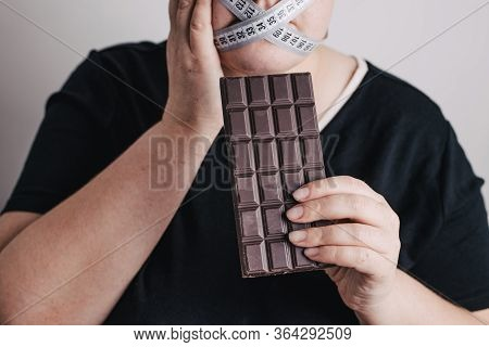 Diet Restricts, Weight Loss, Eating Disorder. Anorexia And Bulimia Concept. Obese Woman With Chocola