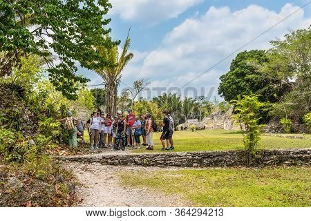 Kohunlich, Mexico - April 25, 2019: A Group Of Tourists Visiting The Ruins Of The Ancient Mayan City