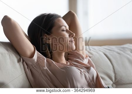 Close Up Calm Young Woman Resting Sleeping On Couch
