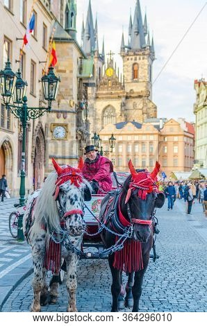 Prague, Czech Republic, May 13, 2019: Horse Carriage Coach For Tourists Entertainment In Old Town Sq