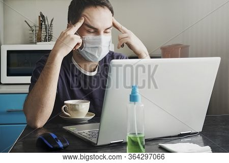 A Tired Young Worker In A Medical Mask Works From Home In The Early Morning. Stay At Home During A P