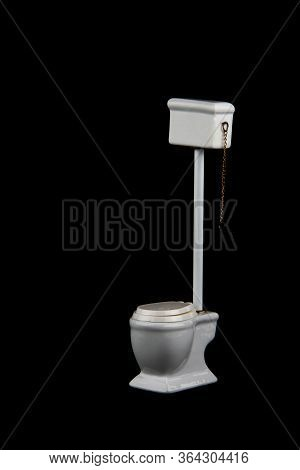 Tank Type Water-closet Isolated On Black Background Flat Lay. Image Contains Copy Space