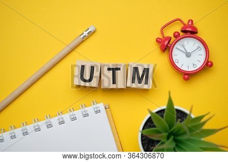 Modern Marketing Buzzword Utm - Urchin Tracking Module. Top View On Wooden Table With Blocks. Top Vi