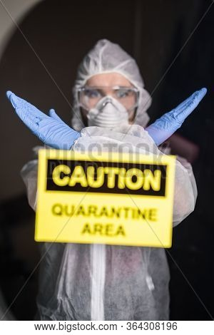Man In Protective Suit And In Protective Medical Mask Showing Stop Gesture. Epidemiologist Show Gest
