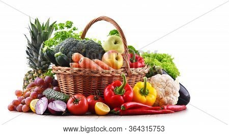 Assorted Organic Vegetables And Fruits In Wicker Basket