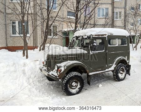 Kirovsk (murmansk), Russia - 02 13 2019: An Old Gaz 69 (then Uaz 69) Off Road Vehicle Covered In Sno