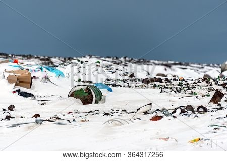 Teriberka (murmansk), Russia - 02 16 2019: Illegal Trash Dump In The Arctic Snow Polluting The Prist