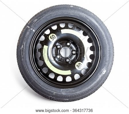Full-size Spare Tire Of A Black Auto Isolated On A White Background In A Photo Studio. Spare Summer