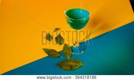 Setting Of Alcoholic Beverage On Multi-colored Background. Stock Footage. Blue Alcoholic Drink Stand