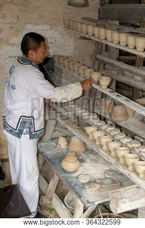 Porcelain Craftsman Working In The Pottery Workshop In Jingdezhen, China