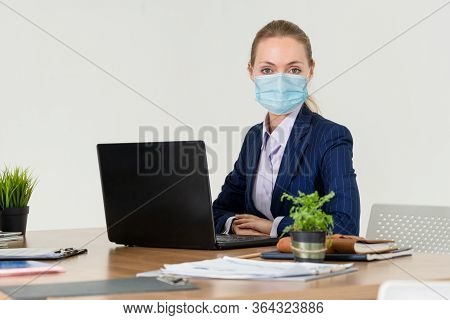 Office Worker With Face Mask Quarantine From Coronavirus Or Covid-19.