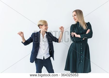 Teenager And Single Parent - Young Mother And Son Dancing Together On White Background.