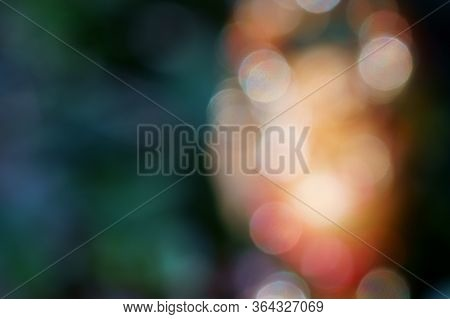 Blurry Background. Buddha Statue In Wild Flowers. The Symbol Of Feng Shui.