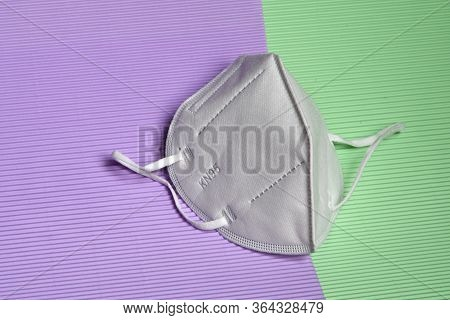 Closeup Of Antivirus Protection Masks Ffp2 Or Kn95 On Colored Background. Prevention For Coronavirus