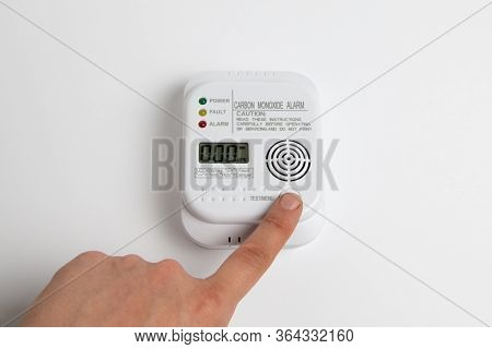 Testing Carbon Monoxide Detector On A White Wall. Stay Home Safe. Home Control And Security. Co Dete