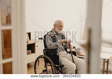 Man On A Wheelchair