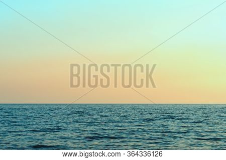Bright Sunset Against The Sky And The Sea. Sunset On The Beach. Beautiful Sunset Over A Calm Ocean O