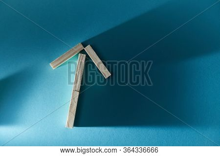 Increase And Growth. Business Expansion. Arrow Made Of Wood On Blue Backdrop. Copy Space. Rise And I