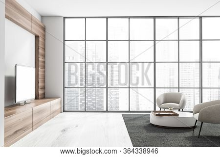 Interior Of Panoramic Living Room With White And Wooden Walls, White Wooden Floor, Tv Set And Two Wh