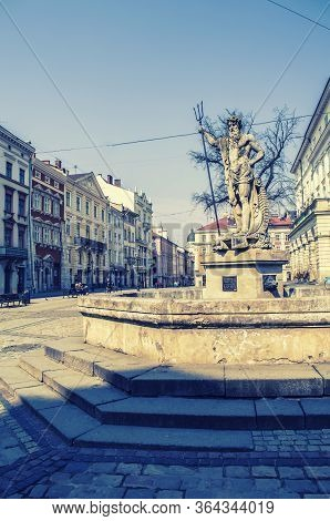 Neptune Monument In Lviv. Central Market Square In Lviv. Historic Monument Of Unesco.