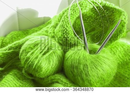 Threads And Knitting Needles. Knitting Blankets. Knitted Sweater. Needlework As A Hobby And Business