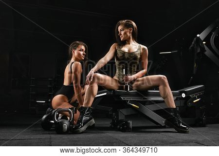 Bodybuilding, Fitness Motivation Concept. Two Sexy Girls In The Gym. Fitness Bikini, Girls With Beau