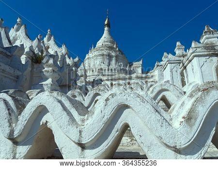 Selective Focus Of The White Hsinbyume Pagoda Or Mya Thein Dan Pagoda In Mingun, Myanmar, With Blue