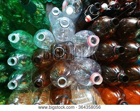 A Lot Of Plastic Bottles For Recycling. Plastic Processing Plant, Washing Of Old Colored Bottles, Mu