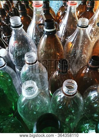 Plastic Bottles Without Caps.vertical Photo For Banner. Recycling Plastic.green,brown And Transparen