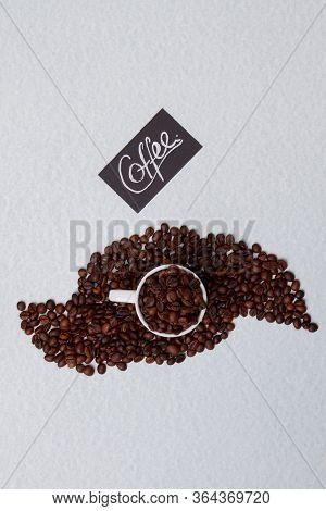 Overfilled Cup Of Coffee. Top View From Above. Isolated On White Background.