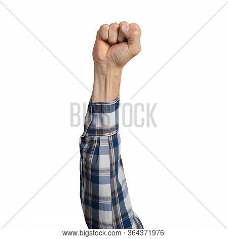 Man Hand In Blue Checkered Shirt Showing Clenched Fist Gesture. Victory Or Protest Sign. Human Hand