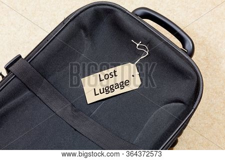 Lost Luggage Concept - Label Which Reads - Lost Luggage - On Top Of A Suitcase