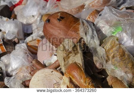 Rotting Sausages Close-up. Various Unsuitable Meat Products In A Garbage Container. Trash Bin Outdoo