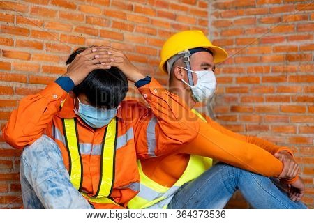 Workers Wear Protective Face Masks For Safety Sitting Worrying About Unemployment Due To The Disease