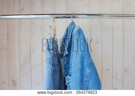 Jeans And Jeans On A Hanger. Fashionable Denim Outfit In Blue Wardrobe. Spring-summer Collection, Cu