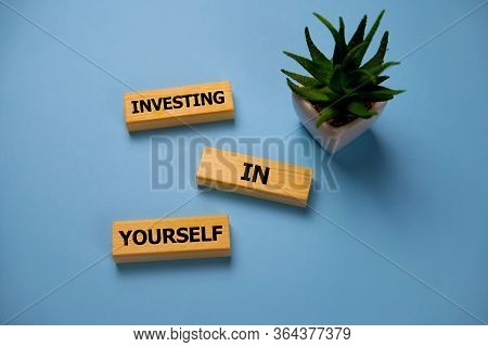 Investing In Yourself - Increase Concept. Inscription On Blue Brick Wall. Investing In Yourself - On