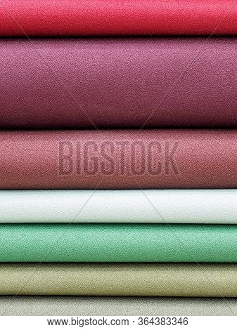Samples Of Viscose In Pastel Pleasant Colors Close-up. The Fabric Is Laid In Layers On The Shelves O