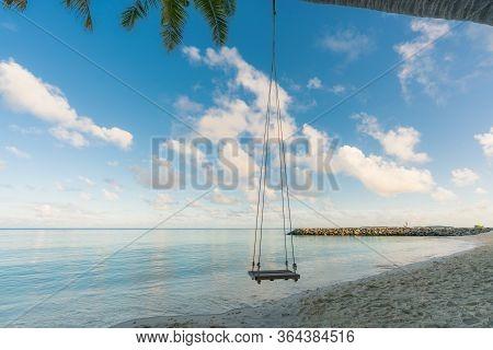 Swing Hangs Under Coconut Tree In Beautiful Tropical Maldives Beach In Massfushi Island, Maldives