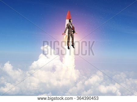 Business Person In Suit Launching Upwards On Rocket. Progress And Innovation Technology. Corporate E